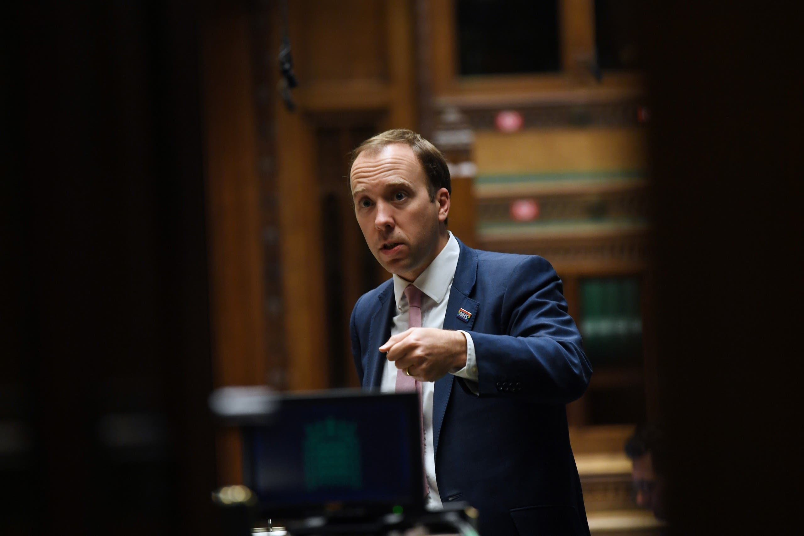 A handout photograph released by the UK Parliament shows Britain's Health Secretary Matt Hancock attending a debate on the novel coronavirus COVID-19, in the House of Commons in London. (AFP)
