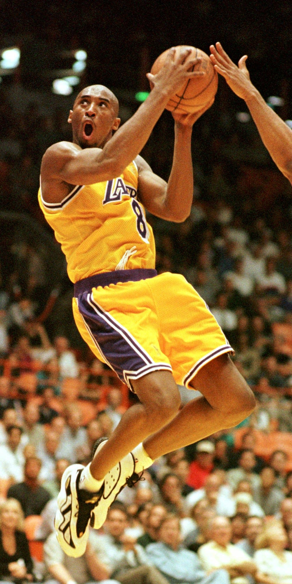 Kobe Bryant of the Los Angeles Lakers goes in for a layup against the Utah Jazz during the second half of their playoff game Thursday, May 8, 1997. (AP)
