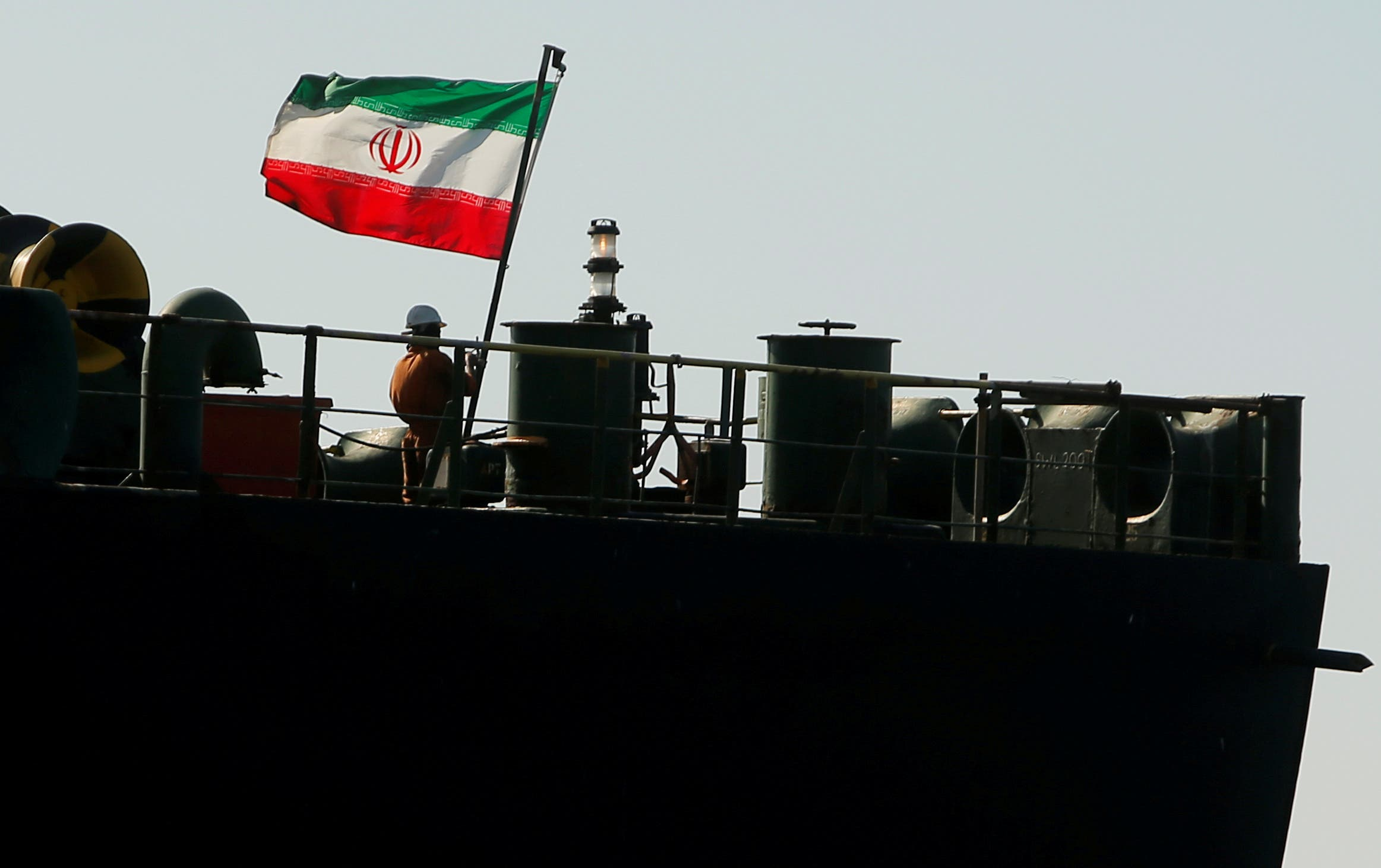 A crew member raises the Iranian flag on Iranian oil tanker Adrian Darya 1 in the Strait of Gibraltar, Spain, August 18, 2019. (Reuters)