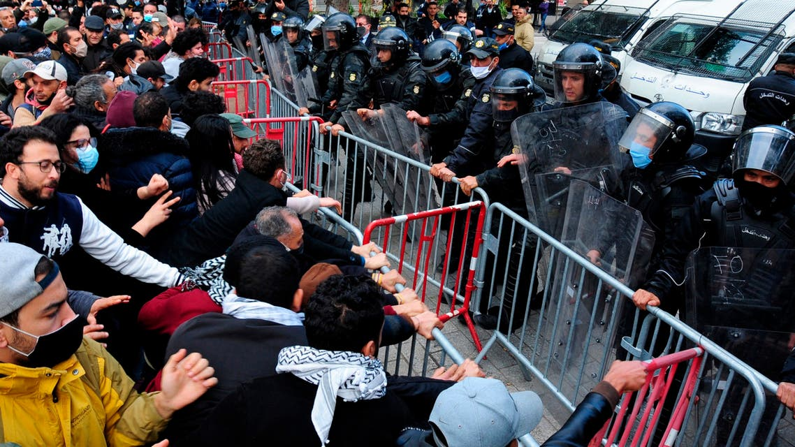Demonstrators face police officers during a demonstration in Tunis on Jan. 23, 2021. (AP)