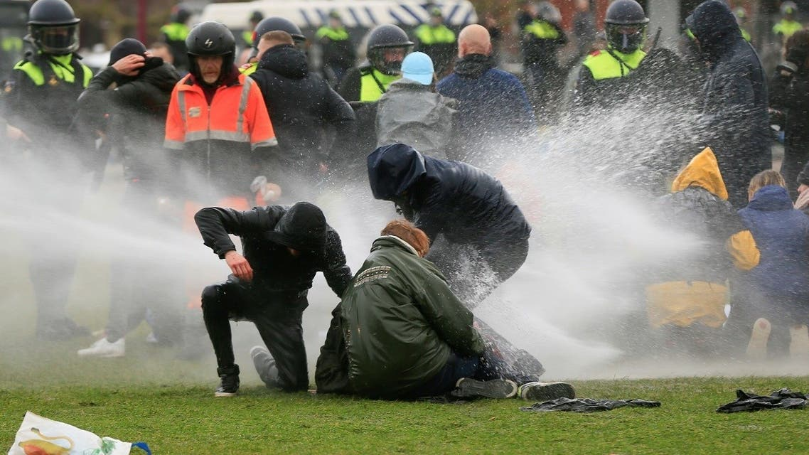 Police uses a water canon during a protest against restrictions put in place to curb the spread of the coronavirus disease (COVID-19), in Amsterdam. (Reuters)