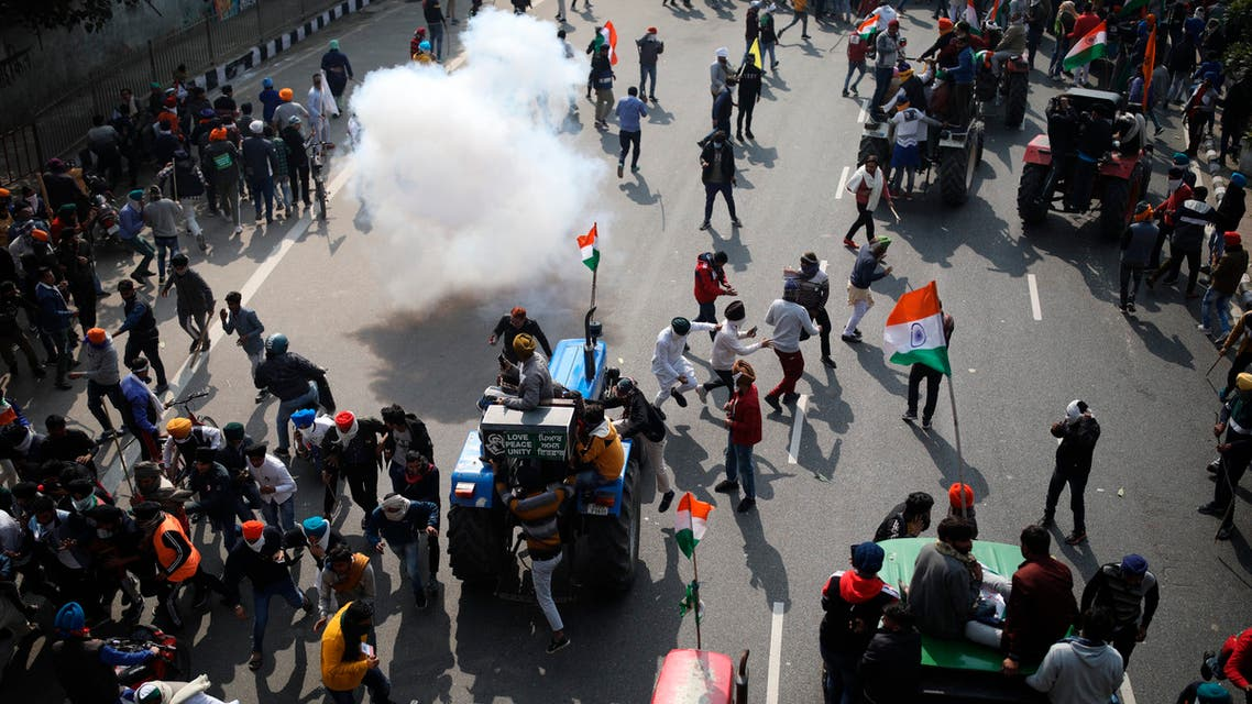 Police use tear gas to disperse farmers who marched to the capital during India's Republic Day celebrations in New Delhi, India, Jan.26, 2021. (AP)