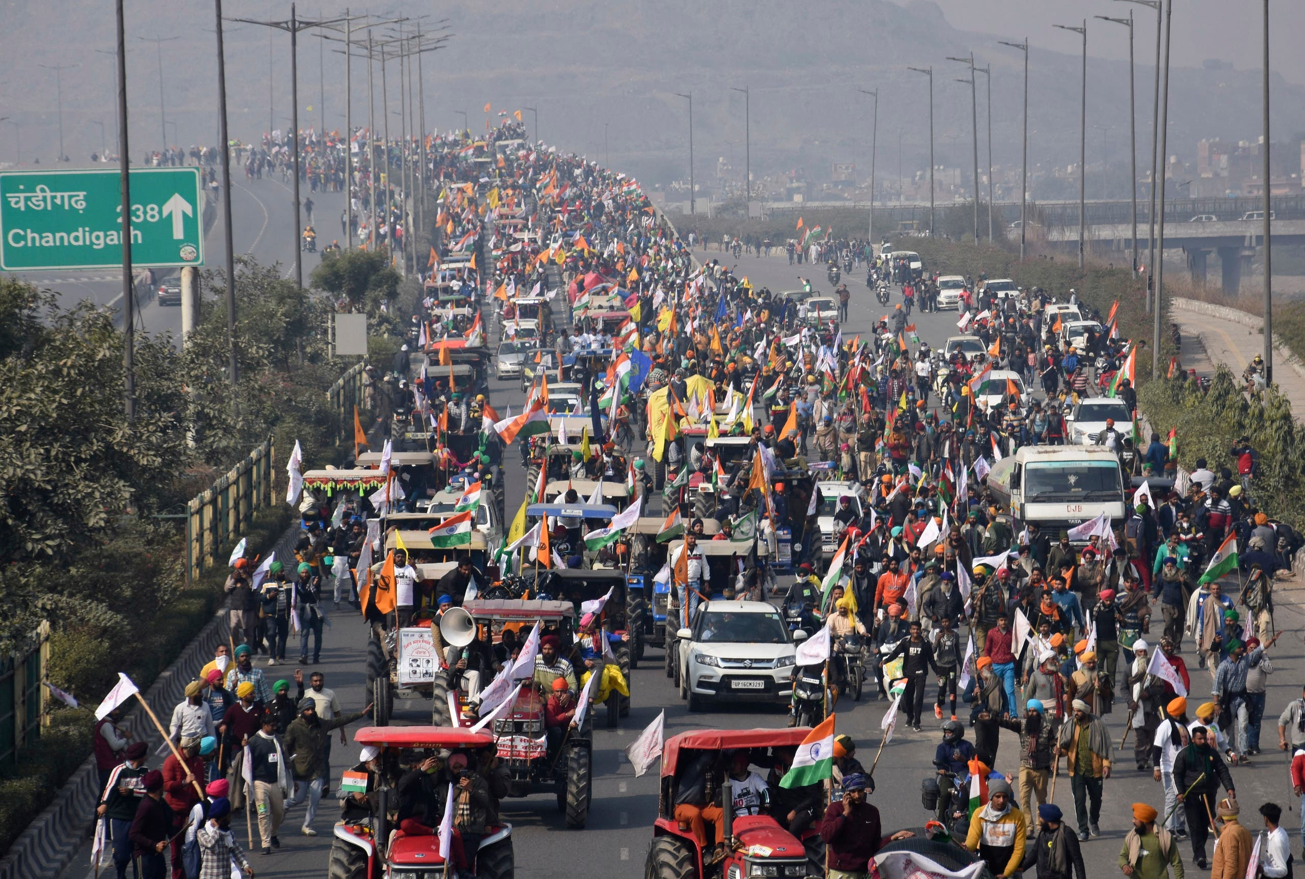 Farmers participate in a protest march towards the capital during India's Republic Day celebrations in New Delhi, India, Tuesday, Jan. 26, 2021. (AP)