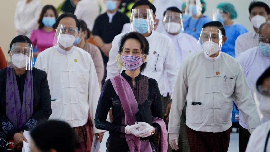 Myanmar's State Counsellor Aung San Suu Kyi looks on as health workers receive a vaccine for the Covid-19 coronavirus at a hospital in Naypyidaw on January 27, 2021. (AFP)