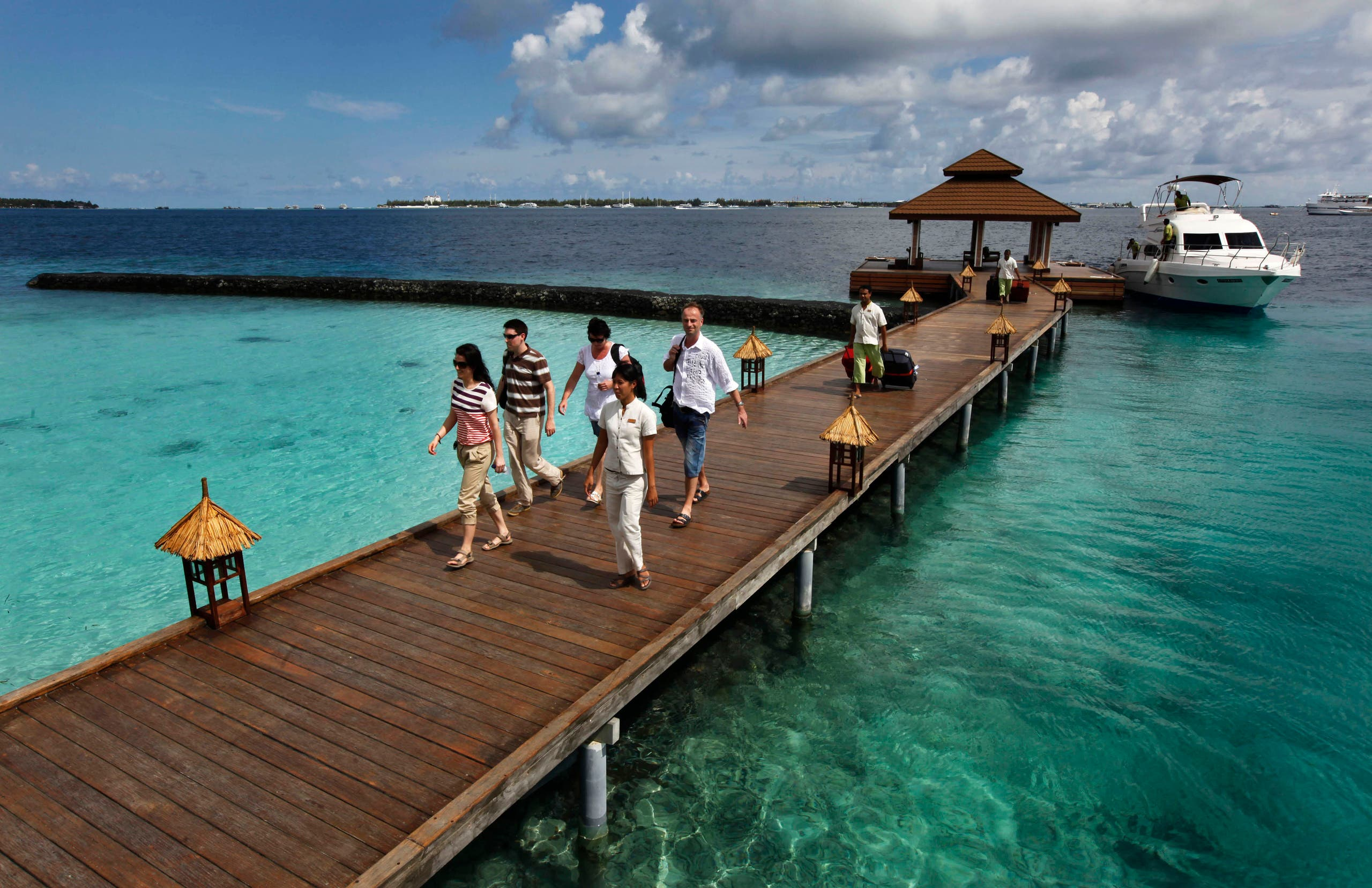 In this file photo, foreign tourists arrive in a resort in the Kurumba island in Maldives. (File photo: AP)