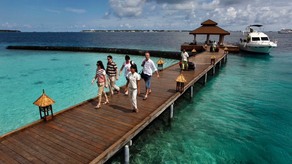In this Feb. 12, 2012 file photo, foreign tourists arrive in a resort in the Kurumba island in Maldives. AP