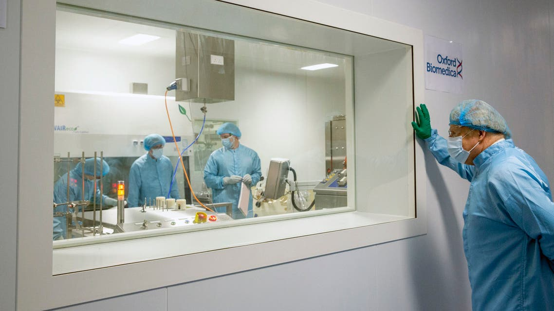 Britain's Prime Minister Boris Johnson at a viewing window during a tour of the manufacturing facility for the Oxford/Astrazeneca vaccine at Oxford Biomedica in Oxfordshire, England, Monday, Jan. 18, 2021. (AP)
