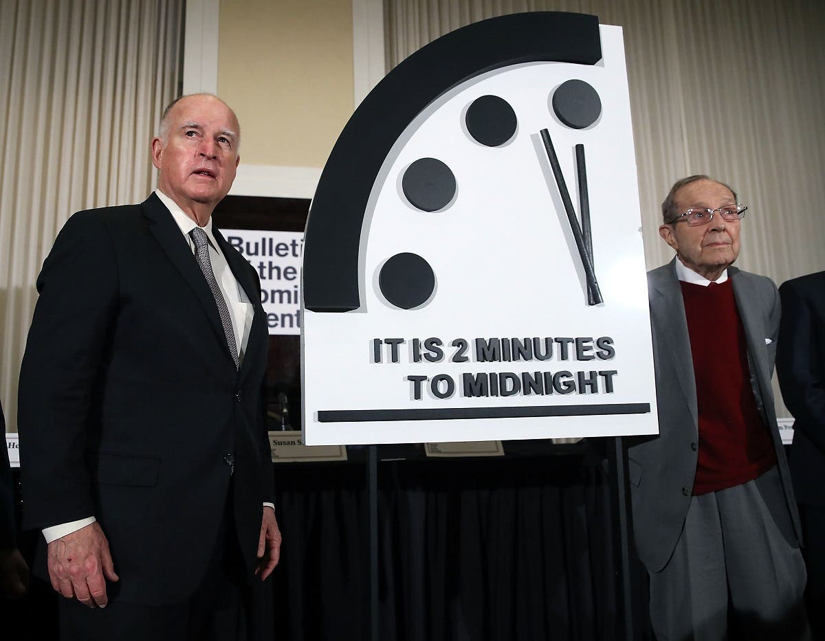 A file photo shows former California Governor Jerry Brown, (L) and former US Secretary of Defense William Perry unveil the Doomsday Clock during The Bulletin of the Atomic Scientists news conference,  January 24, 2019 in Washington, DC. (AFP)