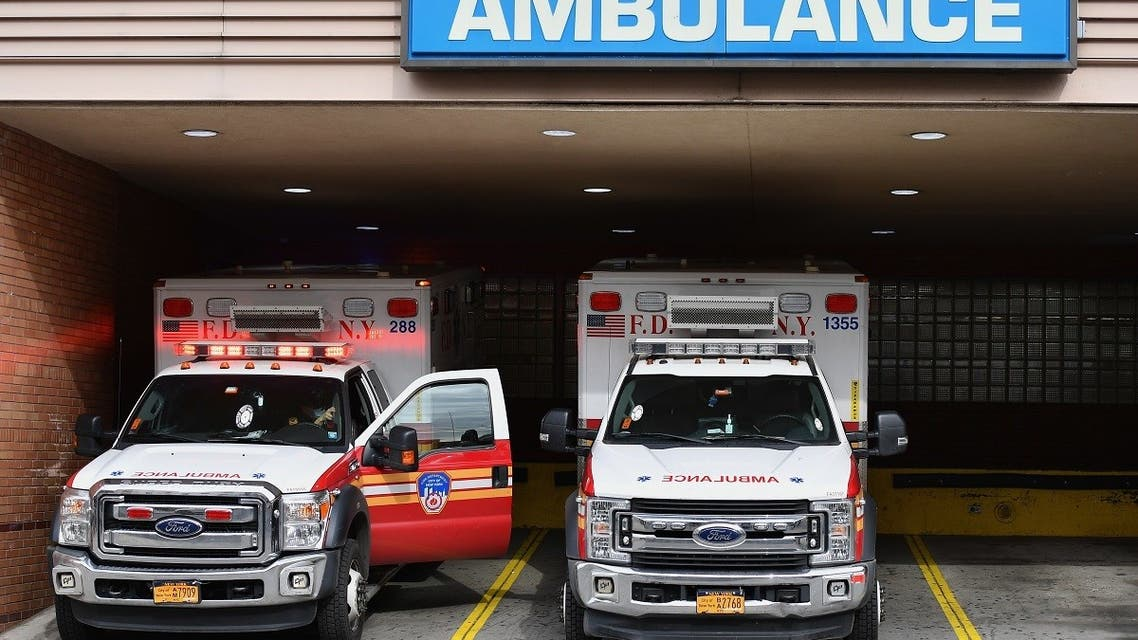In this file photo Medical staff move dead bodies from the Wyckoff Heights Medical Center to a refrigerated truck on April 7, 2020 in Brooklyn, New York. (AFP)