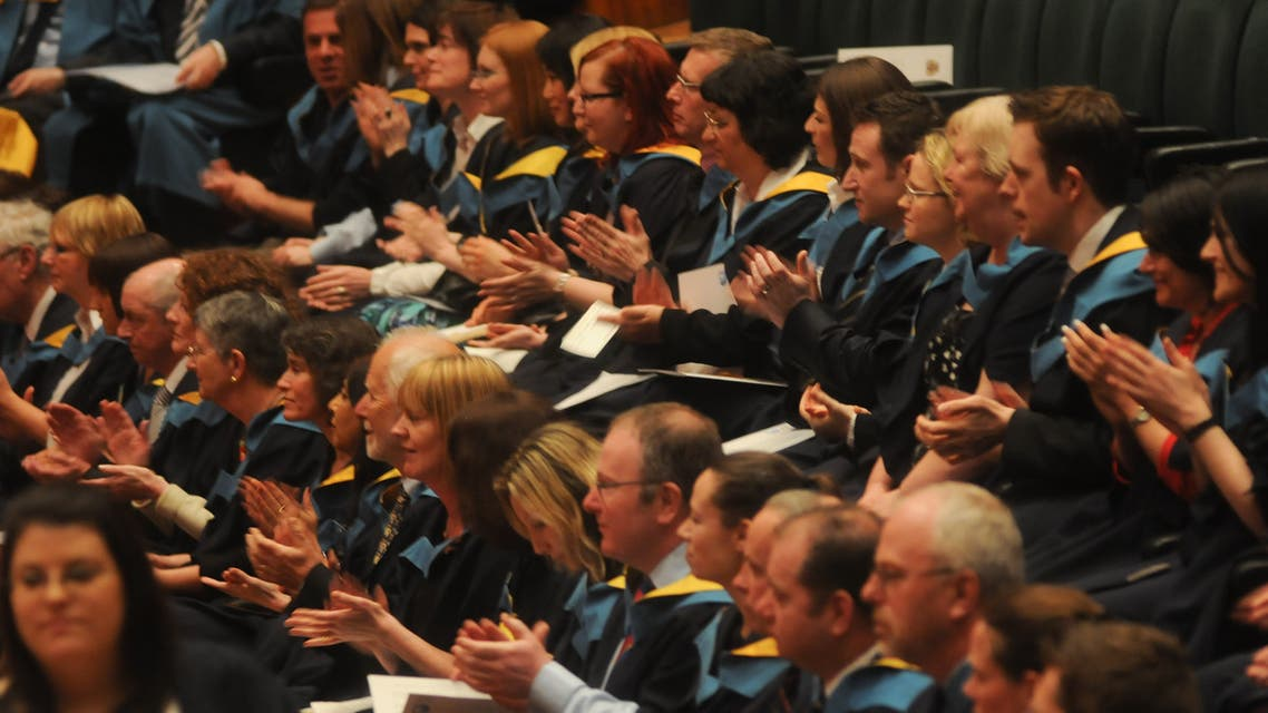 Barbican Ceremony March 2012 grads clapping