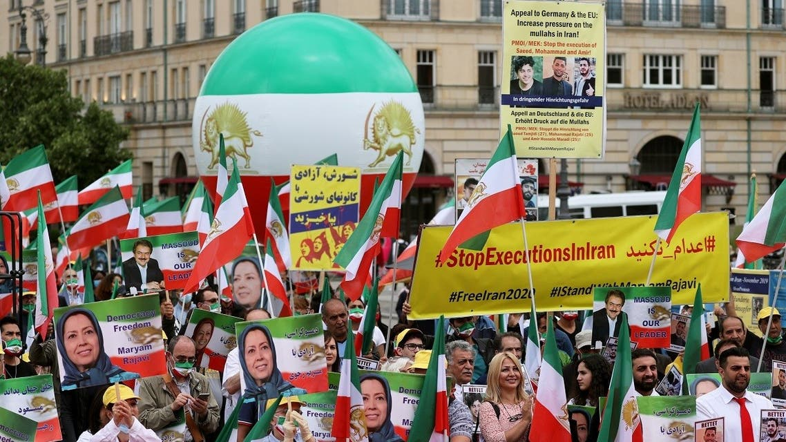 Iranian opposition supporters gather to protest against the death penalty in Iran, in Berlin, Germany, July 17, 2020. (Reuters)