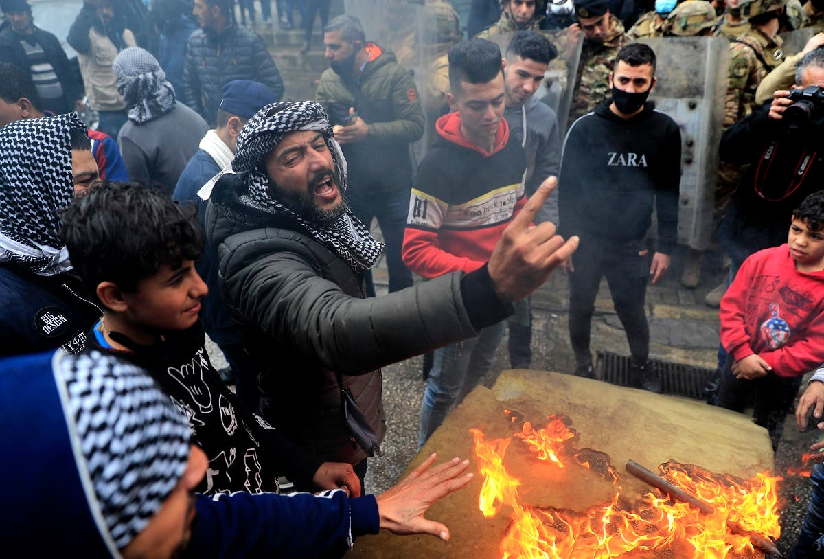Protesters take to the streets in the northern city of Tripoli, Lebanon, Jan. 28, 2021. (AP)