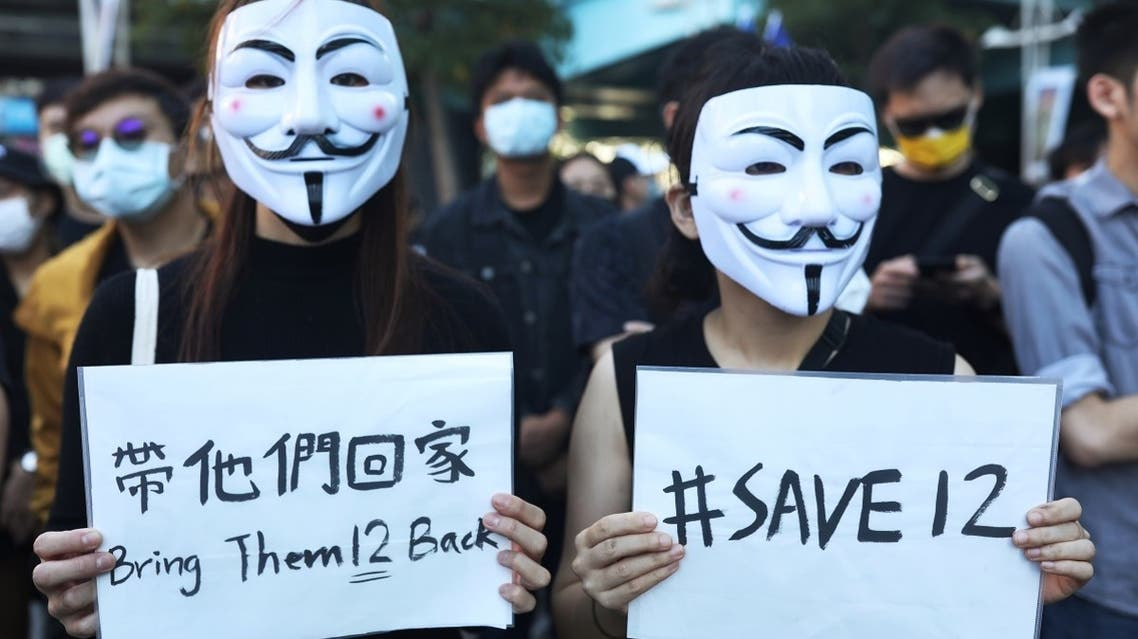 wo protesters holding placards join a rally calling China to release 12 Hong Kong people arrested at sea by mainland authorities, in Taipei, Taiwan. (File photo:Reuters)