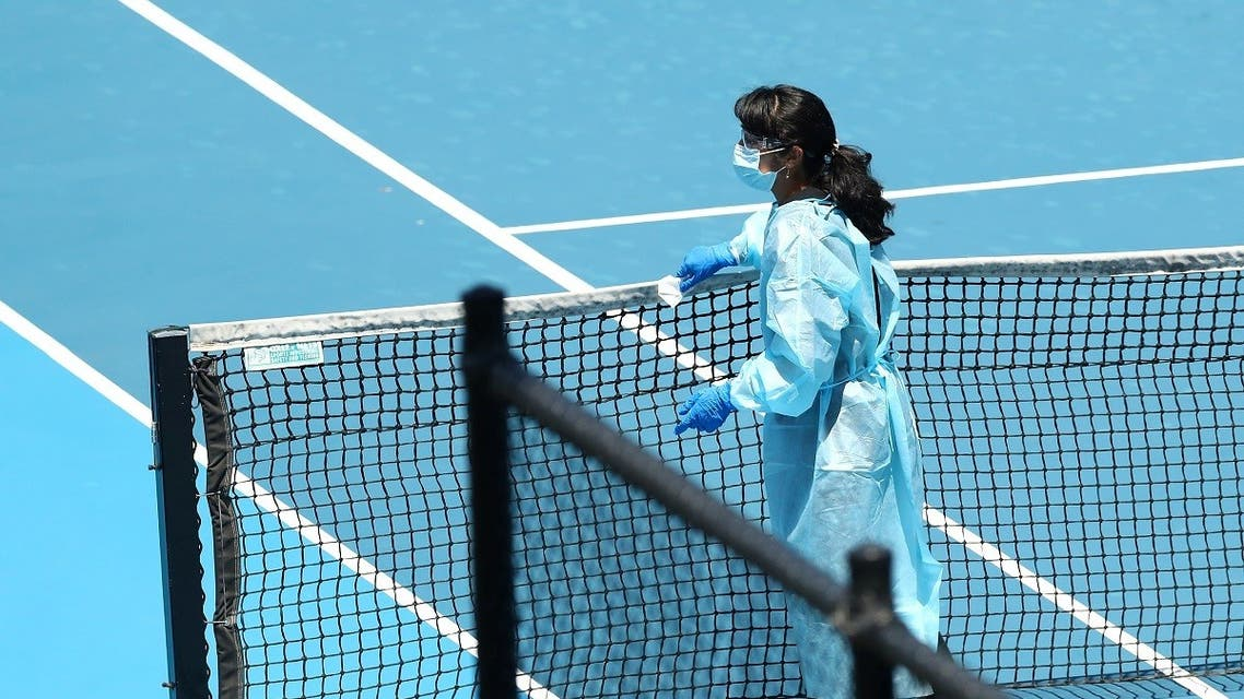 A staff member wearing PPE works to clean surfaces at Melbourne Park in Melbourne. (Reuters)