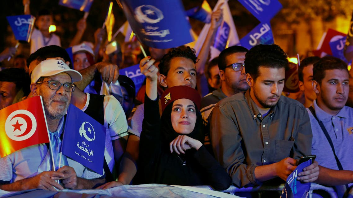 Supporters of Tunisia's moderate Islamist Ennahda party carry flags during a campaign event ahead of the parliamentary elections in Tunis, Tunisia October 3, 2019. Picture taken October 3, 2019. REUTERS/Zoubeir Souissi