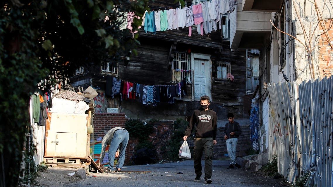 A man walks down a street during a two-day curfew amid the spread of the coronavirus disease (COVID-19), in Istanbul, Turkey, December 6, 2020. REUTERS/Umit Bektas