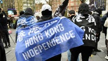 Hong Kong democracy activists say fight will continue abroad amid Beijing crackdown