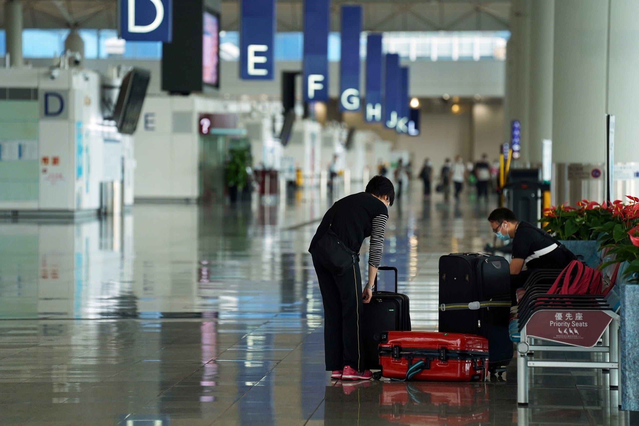 مسافرون في مطار هونغ كونغ (أرشيفية)