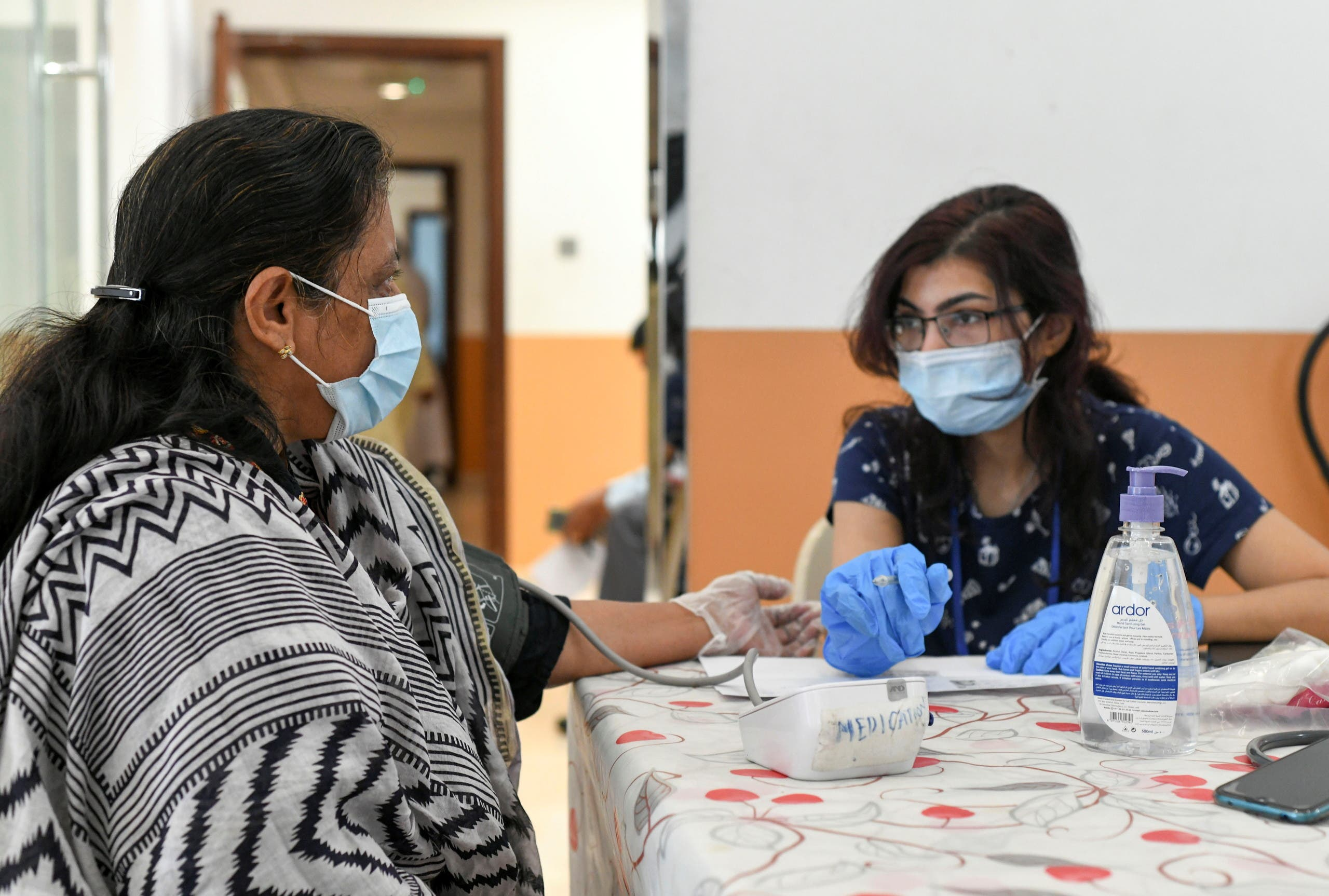 A woman gets tested before receiving a dose of a vaccine against the coronavirus at St. Paul's Church in Abu Dhabi. (Reuters)