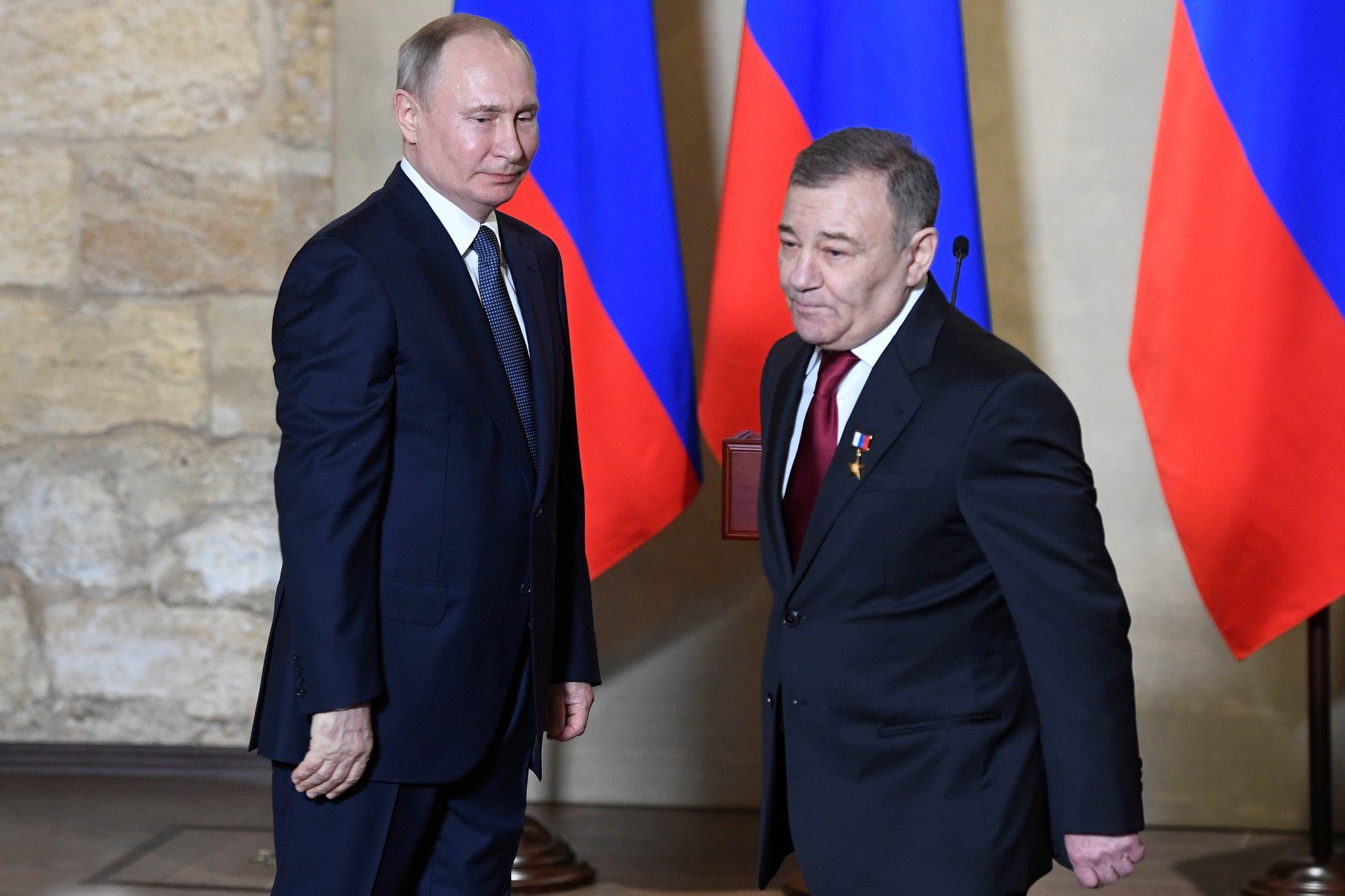 روتنبرغ مع بوتين خلال مناسبة قي القرم في مارس 2020