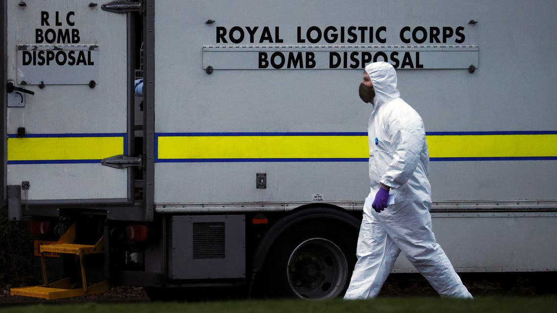 A police forensic officer walks past a bomb disposal unit van outside the Wockhardt pharmaceutical plant in Wrexham, Britain January 27, 2021. (Reuters)