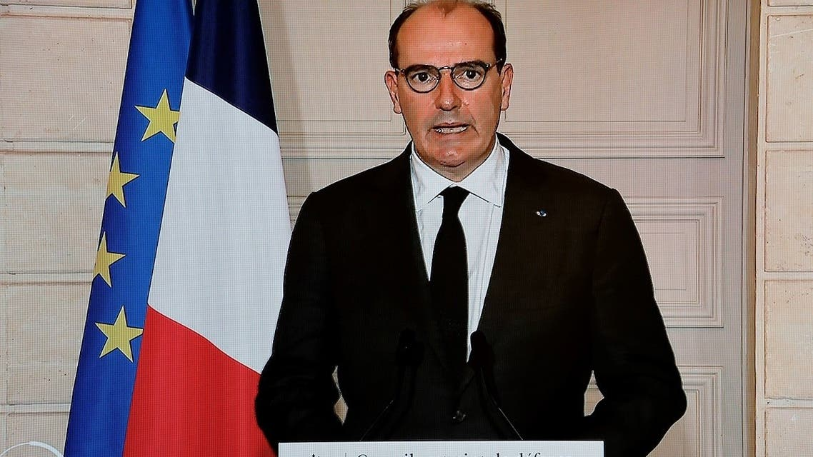 French PM Jean Castex is seen on a TV screen in Paris as he delivers an address following a Sanitary Defense Council on Jan. 29, 2021. (AFP)