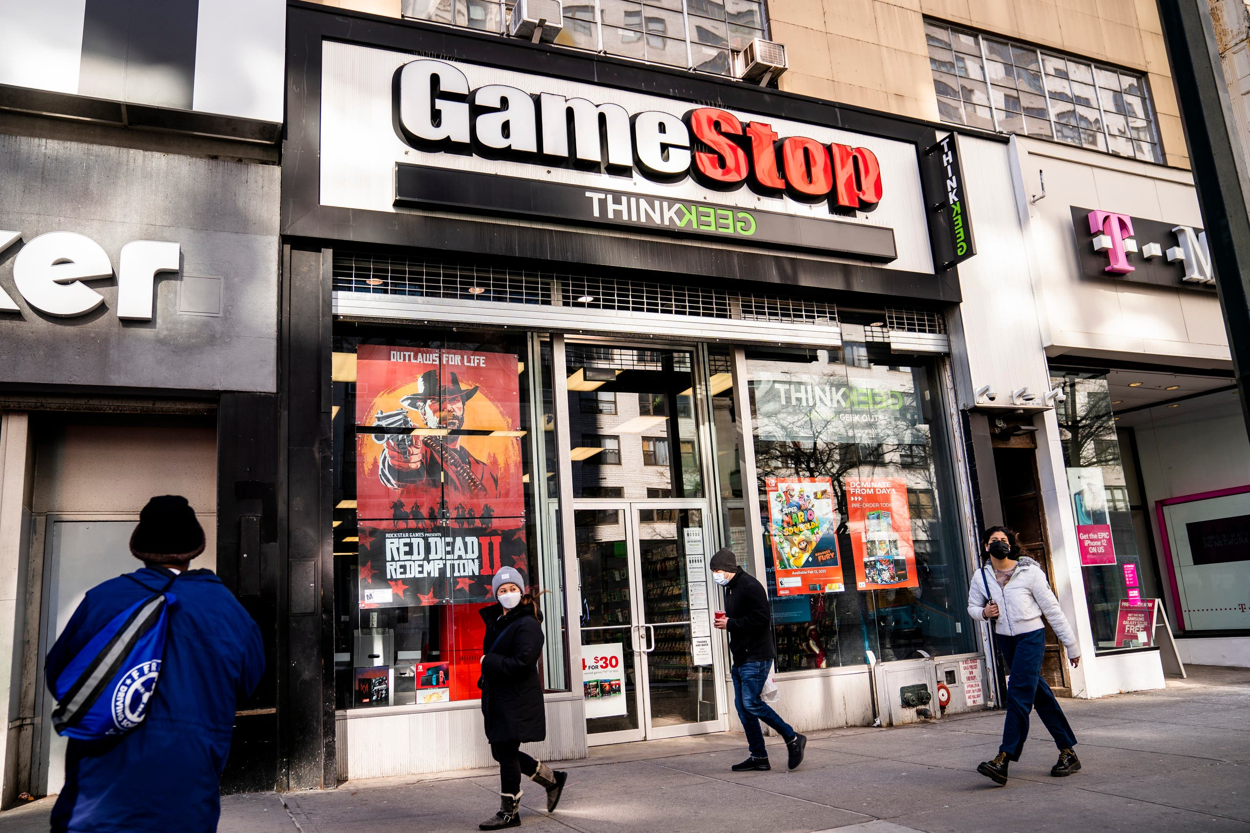 Pedestrians pass a GameStop store on 14th Street at Union Square, Thursday, January 28, 2021, in the Manhattan borough of New York. (AP)