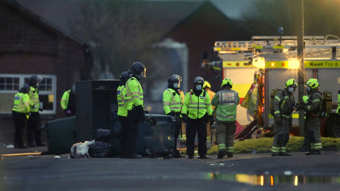 Emergency services attend the scene after a fire broke out at Napier Barracks where asylum seekers are housed in Folkestone, southern England, Friday January 29, 2021. (AP)
