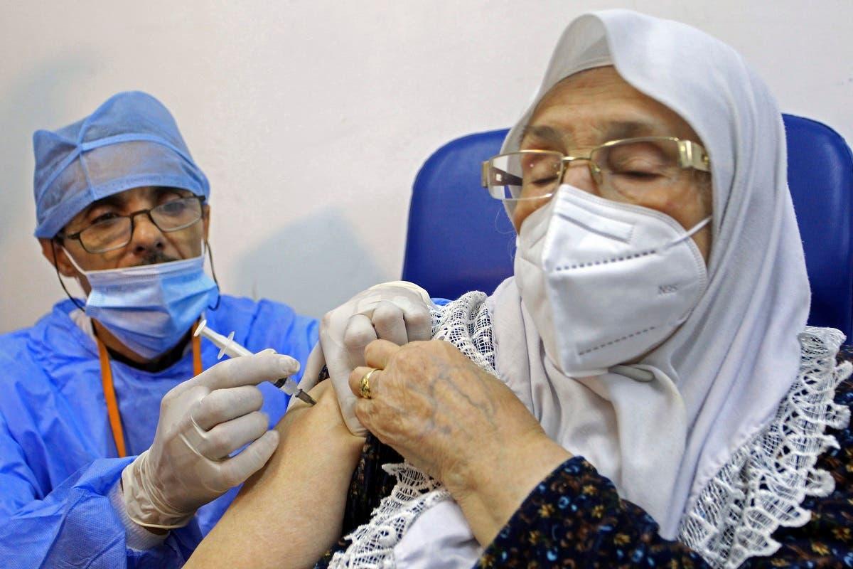 A woman receives the Sputnik-V COVID-19 vaccine at a vaccination center in Blida, south of Algiers, Algeria, Saturday, Jan. 30, 2021. (AP/Fateh Guidoum)
