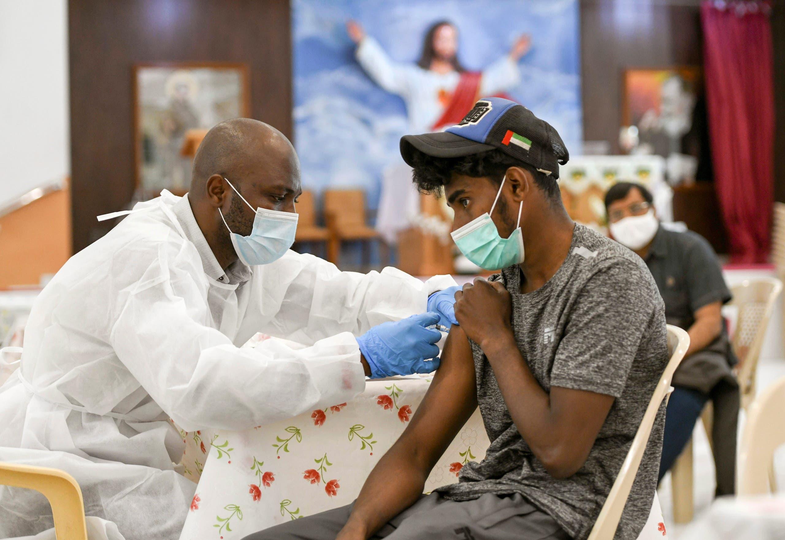 A man receives a dose of a vaccine against the coronavirus disease (COVID-19) at St. Paul's Church in Abu Dhabi, UAE. (Reuters)