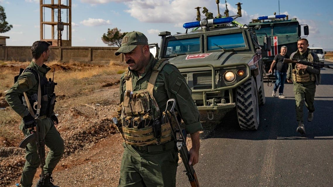 Syrian Kurdish Asayish internal security forces and Russian military police patrol the town of Darbasiyah in Syria's northeastern Hasakeh province along the Syria-Turkey border on October 30, 2019. (Delil Souleiman/AFP)