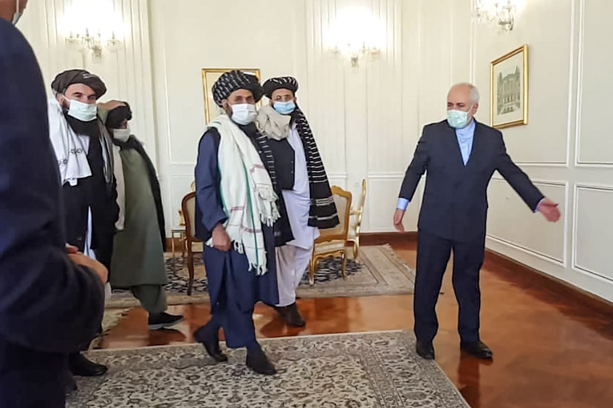 A picture obtained by AFP from the Iranian news agency Tasnim on January 31, 2021, shows Zarif (R) meeting with Mullah Abdul Ghani Baradar (C-L) of the Taliban in Tehran. (AFP)