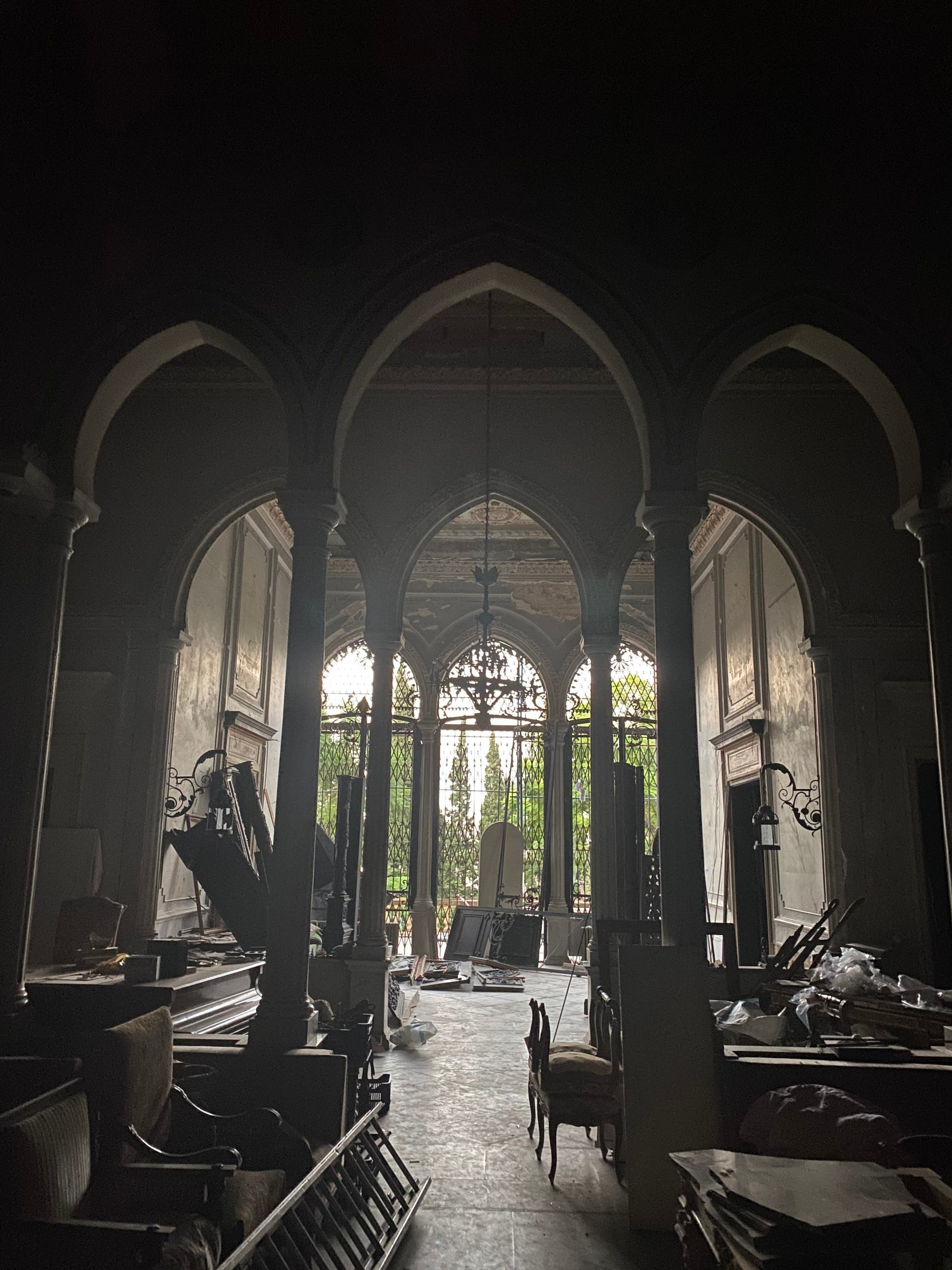Sursock Palace's main hall after the blast, showing shattered triple arcade windows. (Photo by Bassam Lahoud)