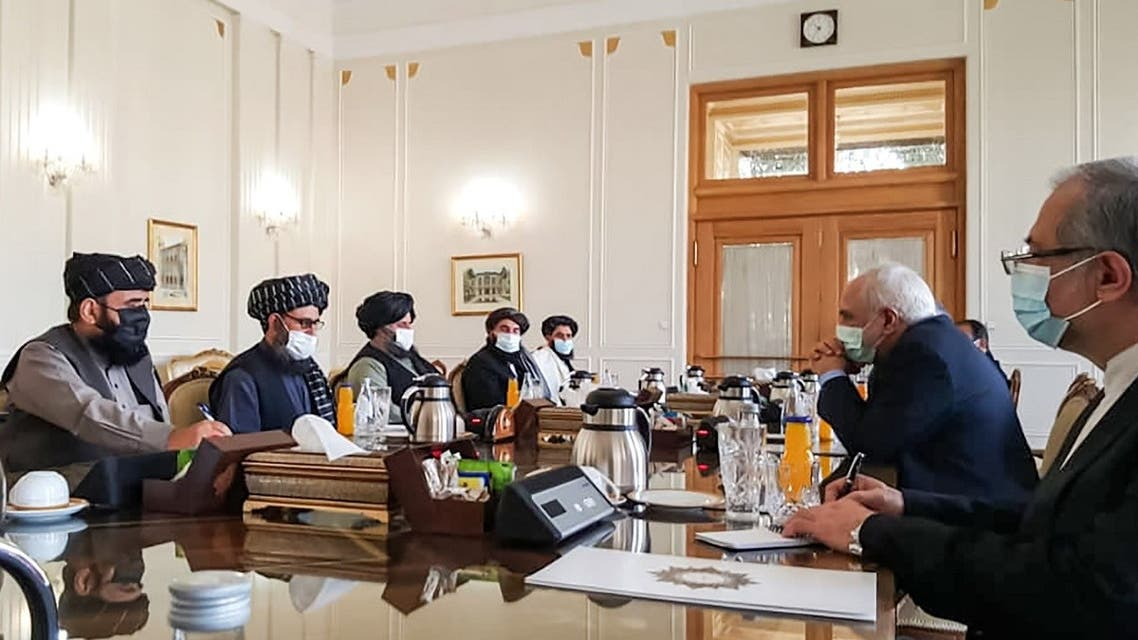 A picture obtained by AFP from the Iranian news agency Tasnim on January 31, 2021, shows  Iran' FM Mohammad Javad Zarif (2nd-R) meeting with Mullah Abdul Ghani Baradar (2nd-L) of the Taliban in Tehran. (AFP)