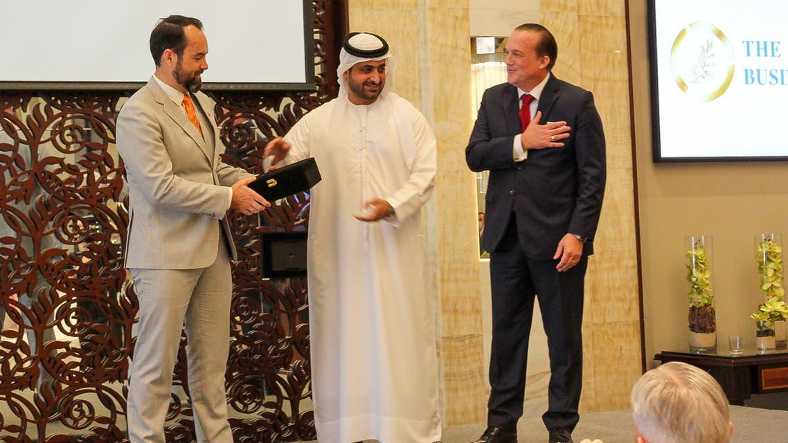 Sheikh Juma Bin Maktoum, center, gives an award to DP World SVP Ryan Quinlan, left, alongside founder of the Abrahamic Business Circle Raphael Nagel. (Supplied)