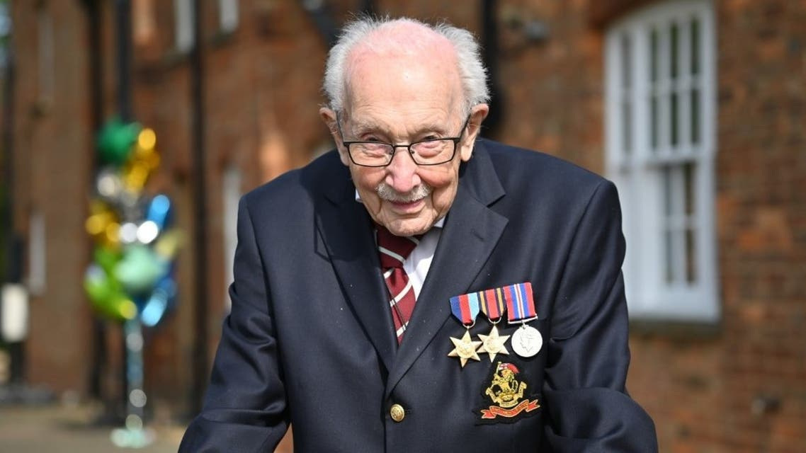 In this file photo taken on April 16, 2020 British World War II veteran Captain Tom Moore, 99, poses doing a lap of his garden in the village of Marston Moretaine, 50 miles north of London. (AFP)