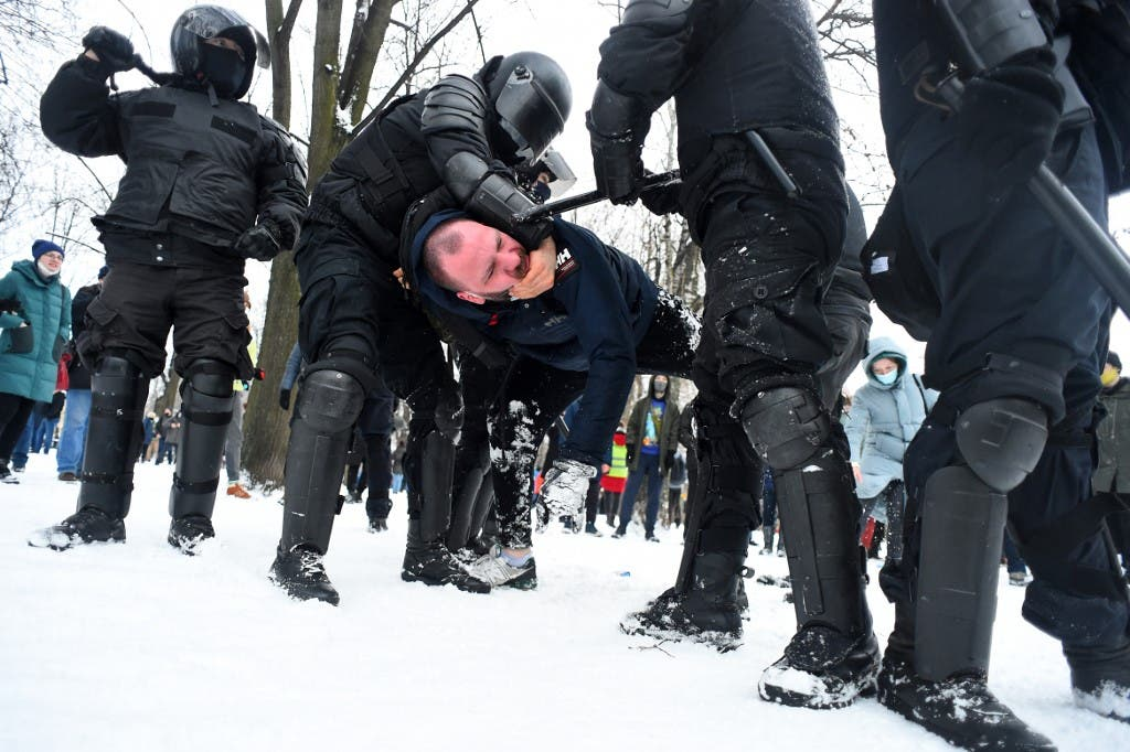 Police detain a man during a rally in support of jailed opposition leader Alexei Navalny in Saint Petersburg on January 31, 2021. (AFP)