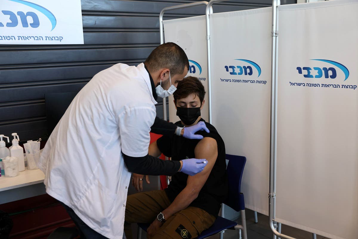 A teenager receives a vaccination against the coronavirus disease (COVID-19), in Tel Aviv, Israel. (File photo: Reuters)