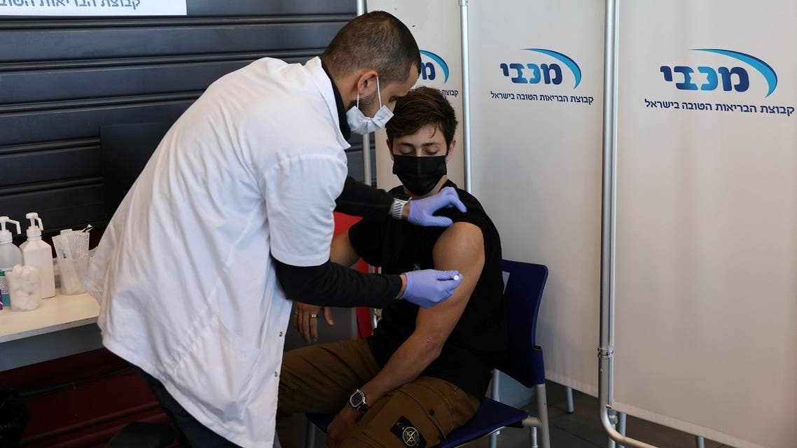 A teenager receives a vaccination against the coronavirus disease (COVID-19), in Tel Aviv, Israel, January 24, 2021. (Reuters/Ronen Zvulun)