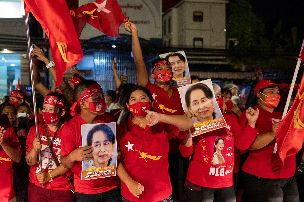 Supporters of National League for Democracy celebrate at party headquarters after the general election in Yangon, Myanmar, on November 9, 2020. (Reuters)