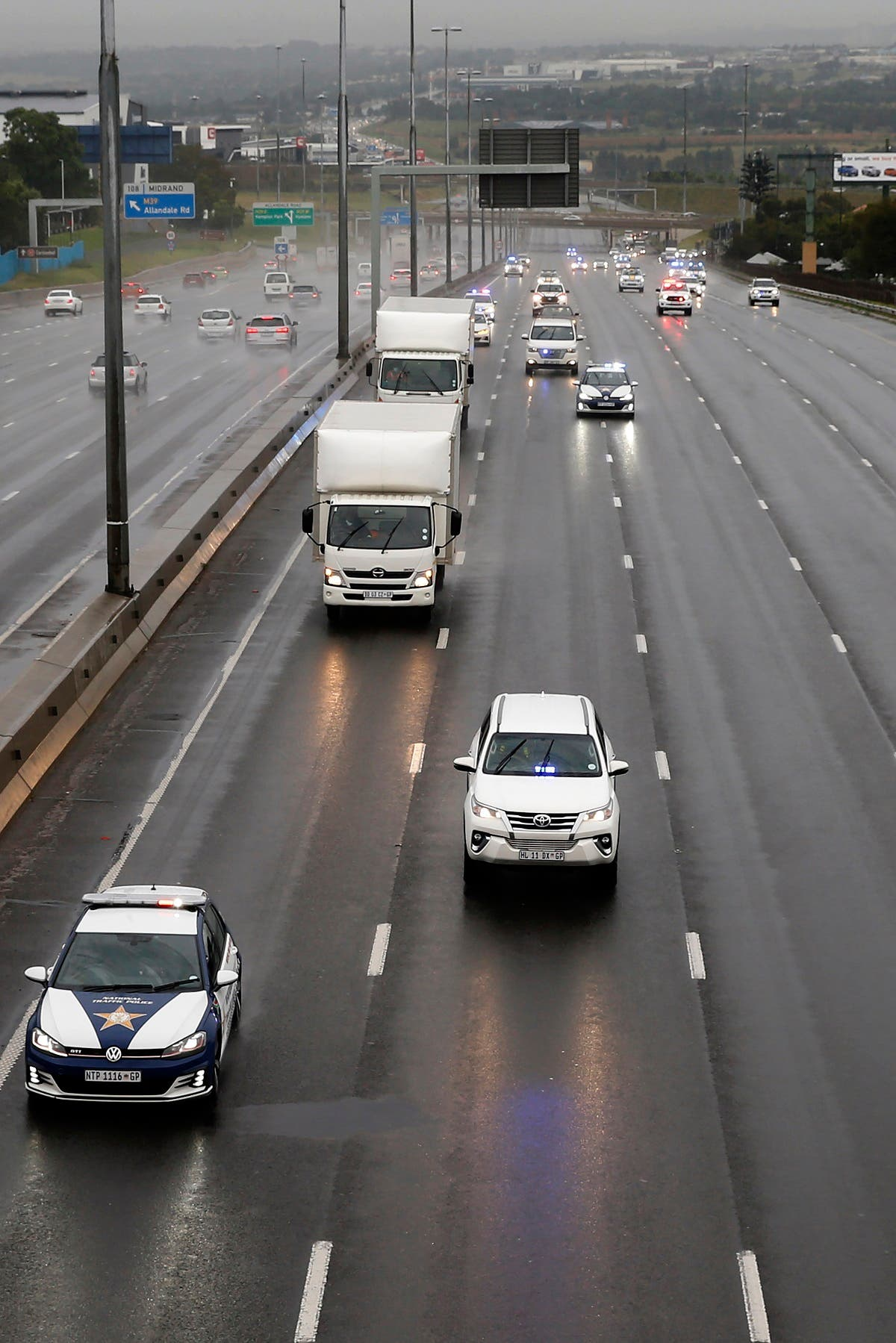 South African law enforcement agencies provide security in Johannesburg on February 1, 2021 for refrigerated trucks transporting AstraZeneca/Oxford vaccines for the Covid-19 coronavirus that arrived at OR Tambo International Airport toward where they will be stored. (AFP)