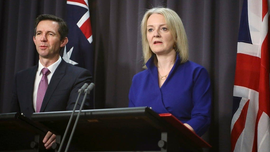 A file photo shows British International Trade Secretary Liz Truss  and Australian Trade Minister Simon Birmingham, left, at a press conference in Canberra, Australia, Sept. 18, 2019. (AP /Rod McGuirk)