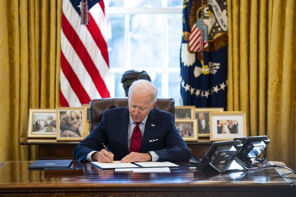 President Joe Biden signs executive actions in the Oval Office of The White House on January 28, 2021 in Washington, DC.  (File photo: AFP)