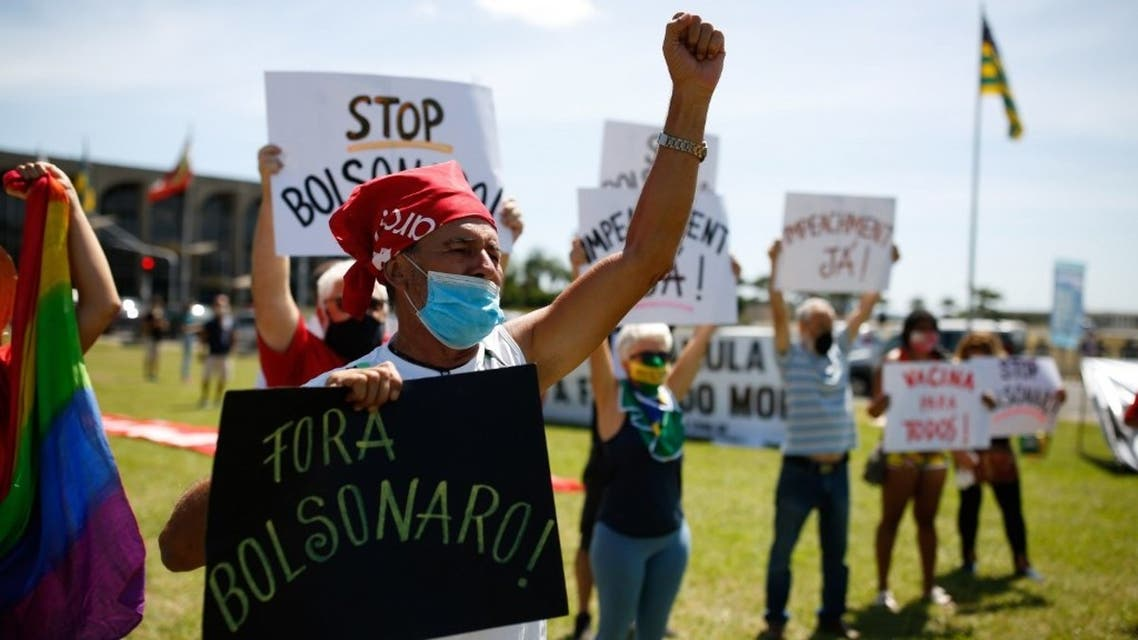 Demonstrators protest against Brazilian president Jair Bolsonaro and his management of the novel coronavirus disease, COVID-19, in Brasilia, on January 31, 2021. (AFP)