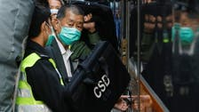 Arrested pro-democracy Hong Kong newspaper owner Jimmy Lai returns to court