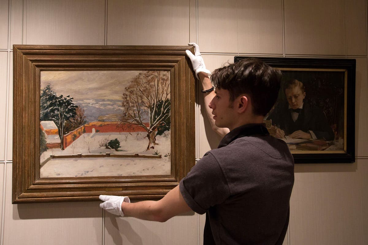 Another painting by Winston Churchill called 'The Weald of Kent Under Snow' at Sotheby's auction house in London, England, Dec. 9, 2014. (AP/Tim Ireland)