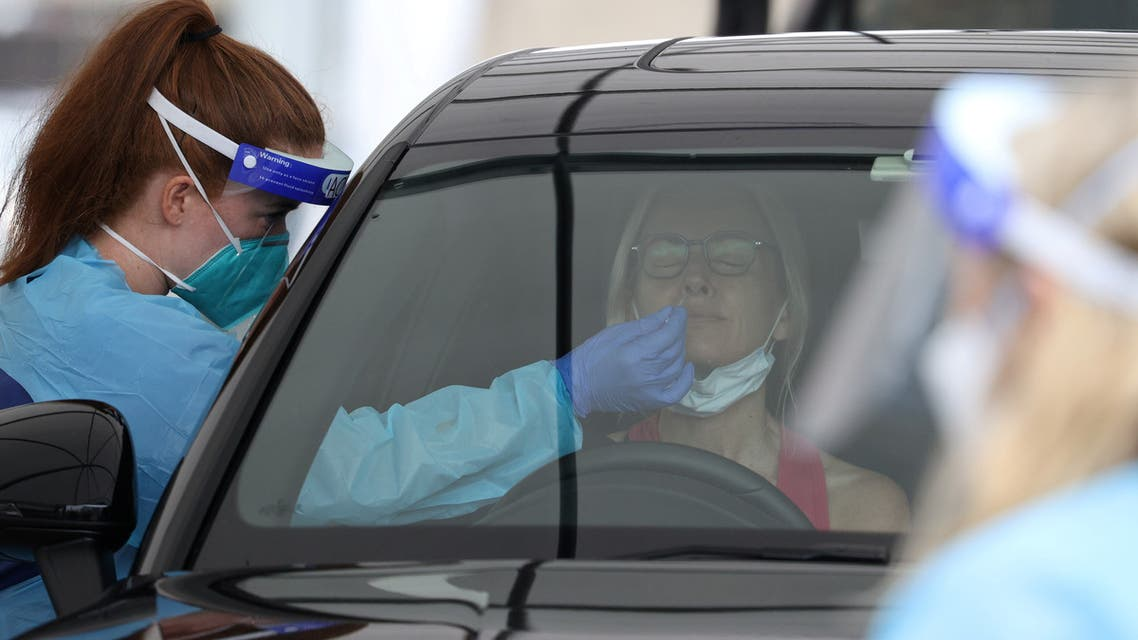 A medical worker swabs a member of the public at the Bondi Beach drive-through coronavirus disease (COVID-19) testing centre as the city experiences an outbreak in Sydney, Australia, December 21, 2020. (Reuters)