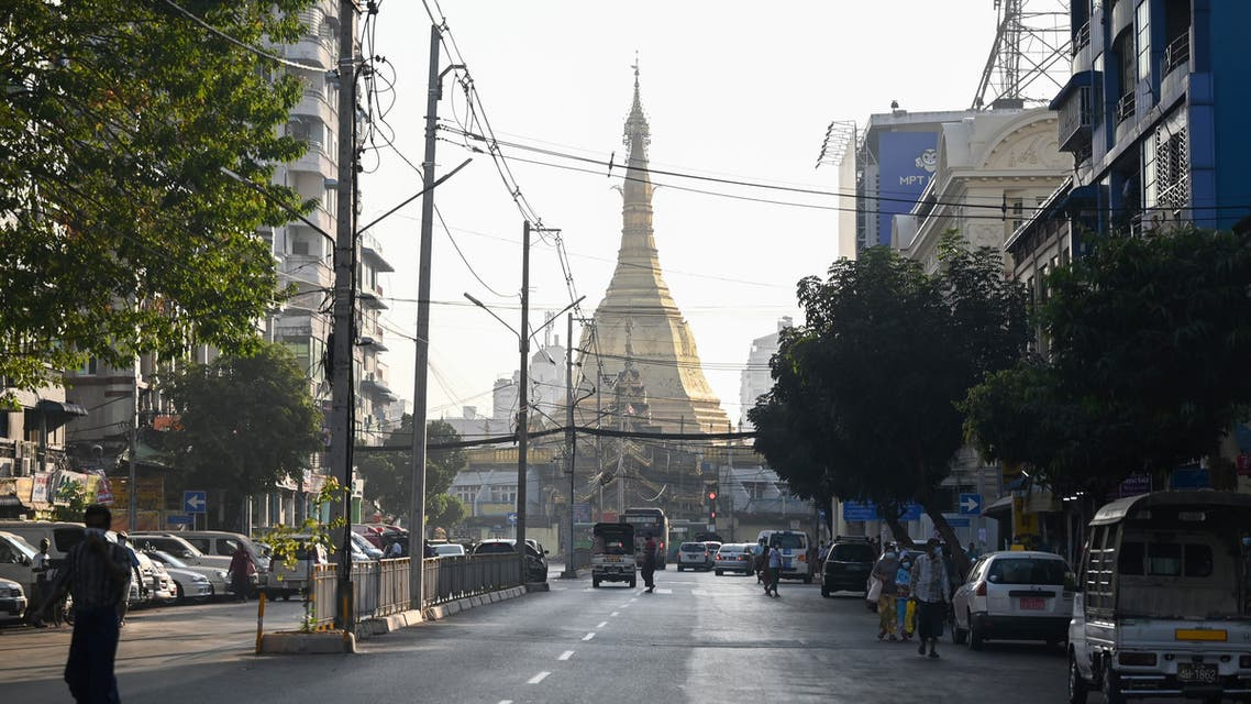 People walk next to Shwedagon Pagoda on an empty road in Yangon on February 1, 2021, as Myanmar's military detained the country's de facto leader Aung San Suu Kyi and the country's president in a coup.  (File photo: AFP)