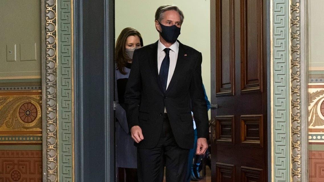 Antony Blinken, accompanied by his wife Evan Ryan, arrives for his ceremonial swearing-in as Secretary of State, Jan. 27, 2021. (AP)