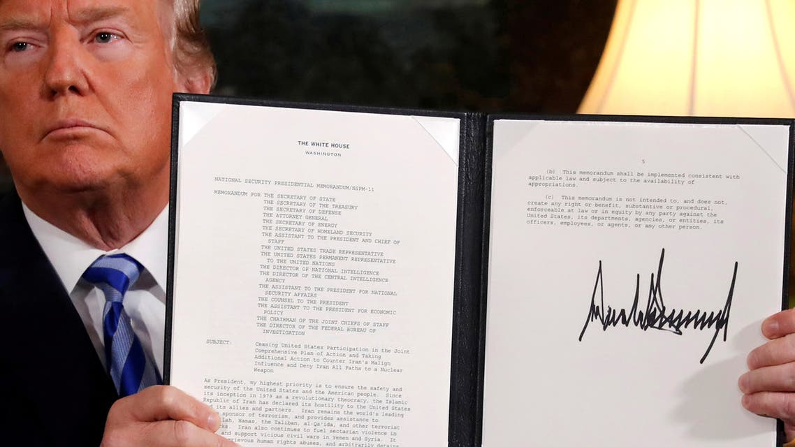 U.S. President Donald Trump holds up a proclamation declaring his intention to withdraw from the JCPOA Iran nuclear agreement after signing it in the Diplomatic Room at the White House in Washington, U.S. May 8, 2018. (Reuters)